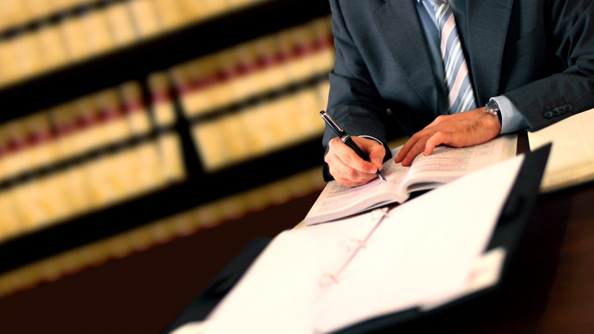 man writing lawyer attorney business man in library